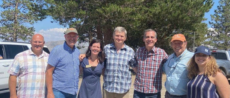 Group photo from Mayor Garcetti's visit to Rush Creek with, from left to right: LADWP General Manager & Chief Engineer Marty Adams, Title, PersonXXXX, Mono County Supervisor Stacy Corless, Mono Lake Committee Executive Director Geoff McQuilkin, LA Mayor Eric Garcetti, Mono County Supervisor Bob Gardner, and Title, PersonXXX all with smiling faces.